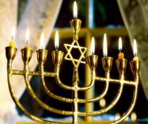 Nine-branched candelabrum with lighted candles, a Hanukiah used in the celebrations of Hanukkah puzzle