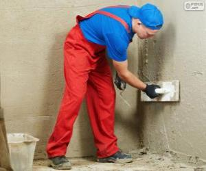 Plasterer working on a wall cladding puzzle