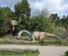 Group of three dinosaurs in the landscape