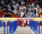 Hurdling, athlet crossing over the hurdle barrier