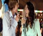 Gabriella Montez (Vanessa Hudgens), Troy Bolton (Zac Efron) singing karaoke