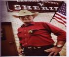 Old sheriff with a cowboy hat and star on his chest