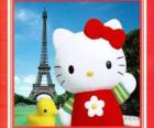 Hello Kitty with a birdie and the Eiffel Tower in background