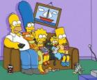 The Simpson family on the couch at home
