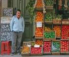 Seller of fruits and vegetables in his shop