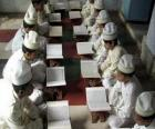 Children reading the Qur'an, Quran, or Koran, the sacred book of Islam