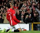 Cristiano Ronaldo celebrating a goal when he played for Manchester United