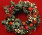 Christmas wreath formed by holly leaves and varied fruits
