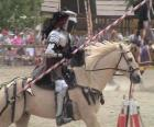Knight in armor and with his spear ready mounted on his horse also protected with armor