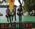 Brothers Shane (Joe Jonas), Nate (Nick Jonas) and Jason Gray (Kevin Jonas) singing at the Camp Rock Beach Jam