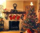 Fireplace in Christmas with the hung socks and with Christmas decorations