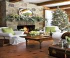 Fireplace with the fire lit and the Christmas decorations