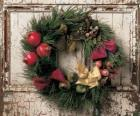 Wreath of Christmas hung in the doorway of a house