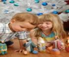 Children playing with the manger