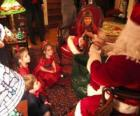 Child talking to Santa Claus