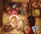 The Child Jesus in the manger with the protection of an angel