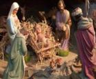 The Holy Family in the stable with the ox and the mule, a shepherd with a sheep and a king giving their gifts to Jesus
