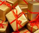 Pile of Christmas presents with red ribbons