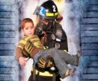 Firefighter holding a child in arms