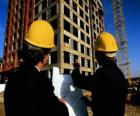 Technician consulting a plane in the building work - Architect, foreman builder, quantity surveyor or engineer