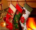 Christmas socks with decoration and hanging on the wall of the chimney