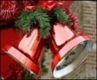 Christmas bells with a big bow and fir leaves