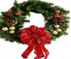 Christmas wreath decorated with a large ribbon and balls