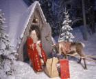 Santa at the door of his house with a reindeer and gifts