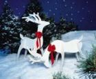 Two wooden reindeer with a red bow on a Christmas decoration