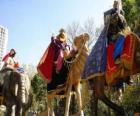 The three Wise Men riding camels