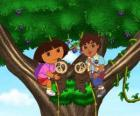 Dora and cousin Diego into a tree two little bears helping