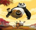 The Kung Fu master Shifu kicks on the backside of Po