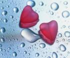 Two red hearts and raindrops