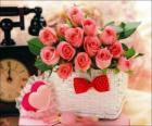 Basket of pink roses and hearts