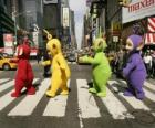 Po, Laa-Laa, Dipsy and Tinky-Winky crossing a street