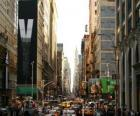 A street in the city of New York with tall buildings and skyscrapers