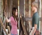 Miley Stewart (Miley Cyrus) speaks with Travis Brody (Lucas Till)