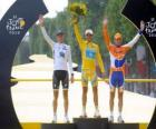 The podium of the 97th Tour de France: Alberto Contador, Andy Schleck and Denis Menchov, in Arc de Triomphe and the Champs Elysees background