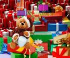 Teddy bear dressed as Santa Claus and with the Christmas gifts
