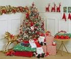 Highly decorated Christmas tree and gifts