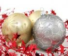 Christmas balls decorated with stars and a ribbon