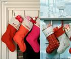 Several hanging Christmas stockings full of gifts