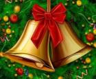 A couple of Christmas bells with a ribbon