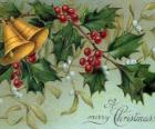 Christmas bells decorated with holly leaves