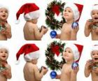 Children with Santa Claus hats and playing with Christmas decorations
