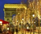 The Champs Élysées decorated for Christmas with the Arc de Triomphe in the background. Paris, France
