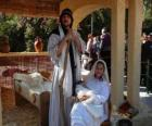 Mary, Joseph and baby Jesus in the manger living