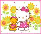 Hello Kitty with a drink in the countryside with her teddy bear Tiny Chum