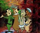 The protagonists of the adventures: Yogi Bear, Boo-Boo, Cindy and the park ranger Smith