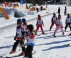 Typical winter scene with children skiing in the mountain